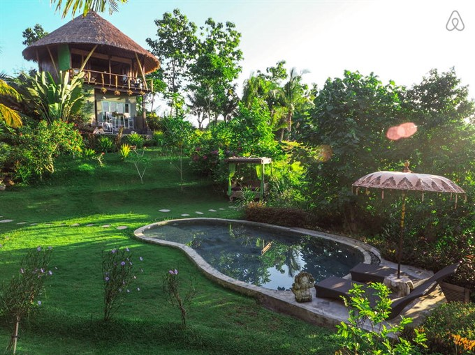 7. Live in a beachside Balinese treehouse