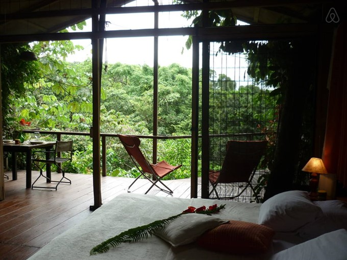 4. Stay in a treehouse nestled in the lush rainforest of Costa Rica