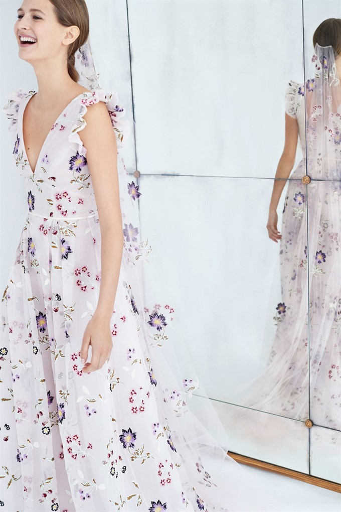 7a6ba3337890e ... very modern and cutting-edge bridal collections featuring contemporary  silhouettes and more casual pieces such as sleek trouser suits, Carolina  Herrera ...