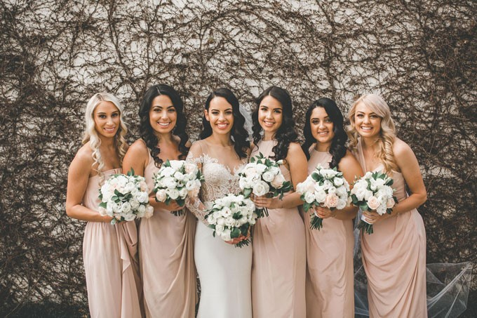 Tips For First-Time Bridesmaids - bride with her bridesmaids