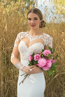 Gown by Martina Liana from Jenny & Gerry's Bridal House, Earrings & Ring by Samantha Wills