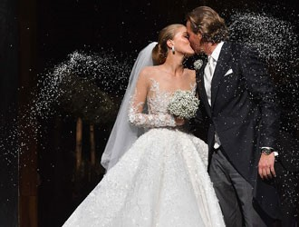 Gemstone heiress marries her long-term partner in lavish Italian wedding.